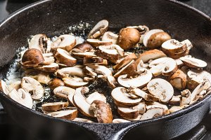 Cooking mushrooms in skillet