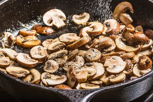 Sliced mushrooms in skillet