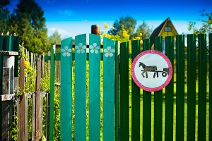 Horse road sign on countryside fence background