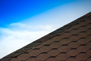 Roof pyramid tiles with sky background