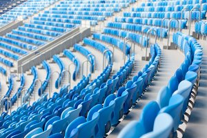 Rows of blue seats at football stadium. Convenient sitting for all