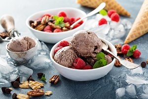 Chocolate ice cream with fresh berries in bowls