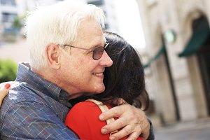 Happy caucasian couple hugging