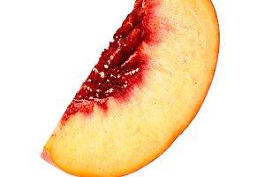 Peach slice isolated on white background macro