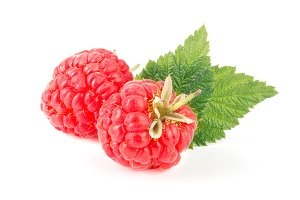 Two raspberries with leaf isolated on white background macro