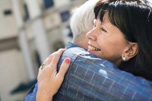Happy senior couple hugging