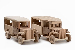 Models of toy cars made of wood.
