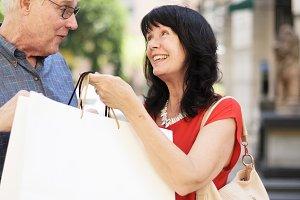 Cheerful senior couple shopping