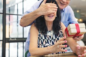 Senior man surprising his wife