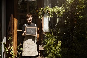 Woman holding board sign garden