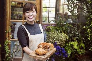 Woman holding Baked Dough Shop