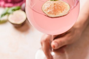 Pink cocktail with fig
