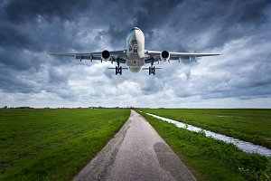 Airplane and country road. Landscape