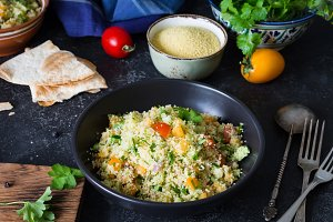 Tabbouleh healthy cous cous salad or side dish in bowl