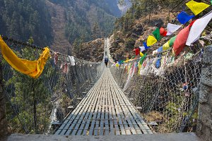 Suspension bridge in mountains