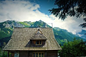 Wooden house in mountains.