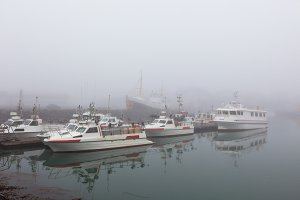 Fishing vessels in a fog