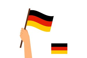 Human hand holding flag of Germany
