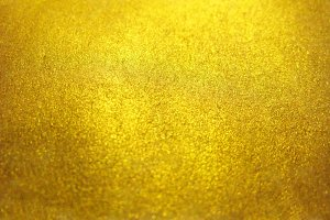 Blurred gold golden metal glitter surface background texture