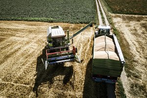 tractor with trailer and harvester