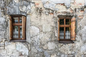 Old window on ancient wall