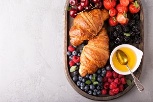 Healthy breakfast with freshly baked croissants and berries