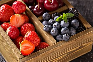 Fresh berries in wooden box