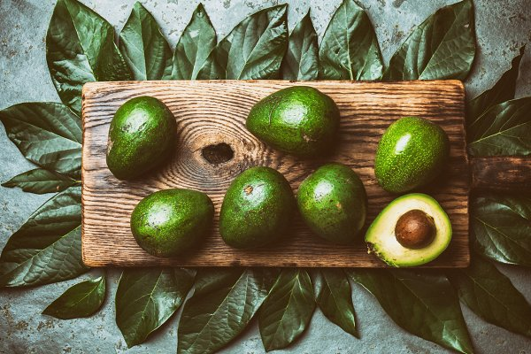 food background with fresh avocado…