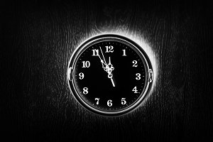 Dark vintage clock on the wall texture background
