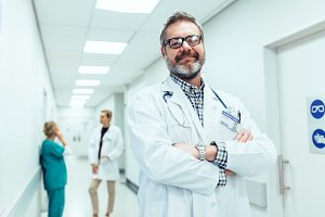 positive doctor standing in hospital