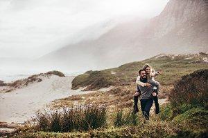 Man giving woman piggyback