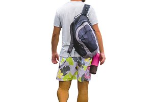 Isolated Man with Summer Clothes Walking Back View