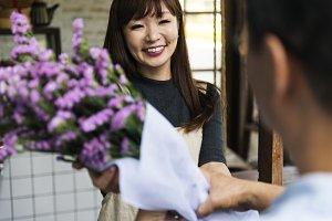Cheerful florist with customer
