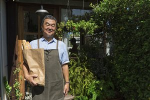 Man holding bag of bakery doughs