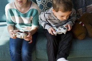 Brother and sister playing game