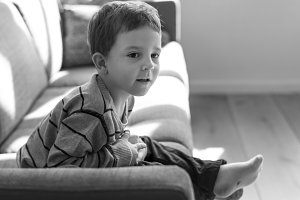Little boy sitting on a sofa