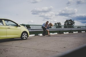 Couple in love traveling by car