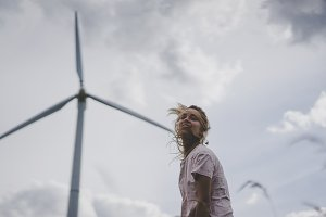girl on a windmill background