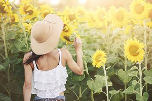 Girl in field of sunflowers