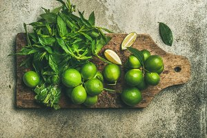 Flat-lay of fresh limes and mint