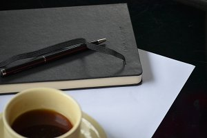 Coffee cup with book & pen