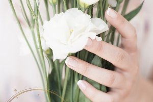 Girl hands holding a large bouquet