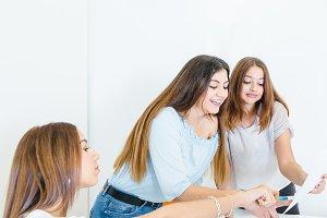 Women brainstorming and doing paperwork