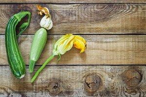 Fresh zucchini on dark wooden background