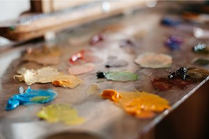 palette of oil paints on glass