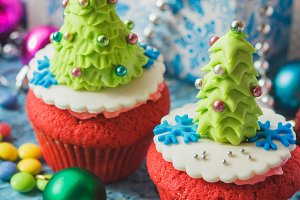 Christmas cupcakes with colored decorative Christmas Tree made from confectionery mastic