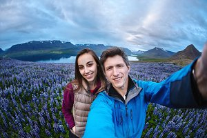 Cheerful couple posing on nature in Iceland