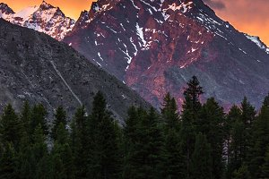 Sunset at snowy mountains landscape