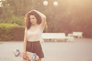 Girl teenager with curly hair