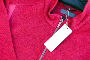 Clothing label tag on a red jacket